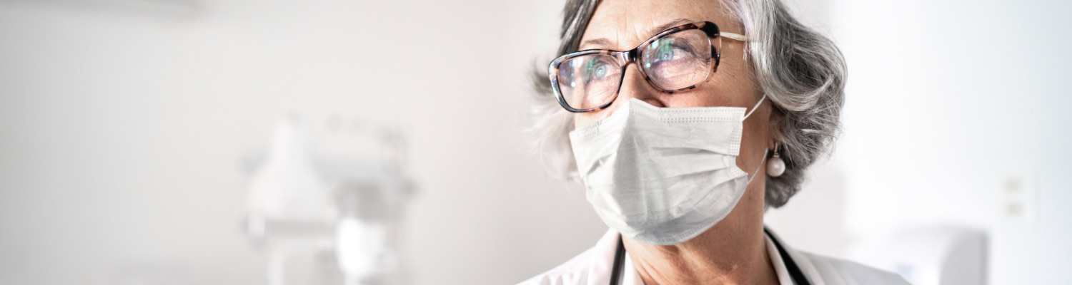 image of a doctor in a protective mask
