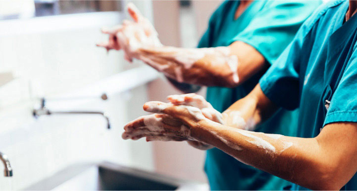 image of a pair of doctors washing their hands