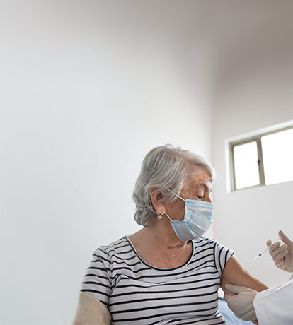 Elderly woman receiving her first dose of the COVID-19 vaccine