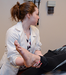 Doctor treating patients ankle/foot