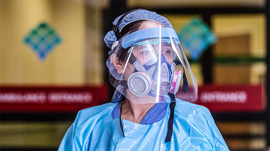 Nurse in PPE equipment