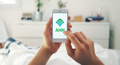 image of a person using the AHN MyChart app from bed