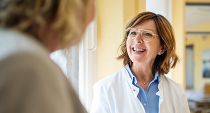 AHN provider smiling as she speaks with her patient