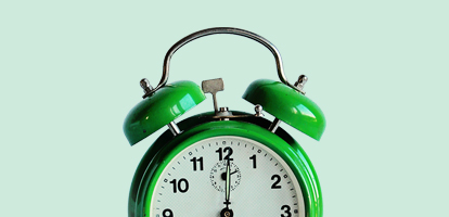 green alarm clock about to ring