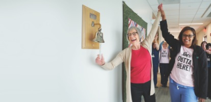 Image of an AHN Cancer Institute patient ringing the bell after successful treatment