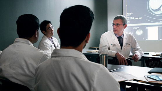 image of a group of oncologists discussing a patient