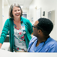 image of a nurse talking to her colleague