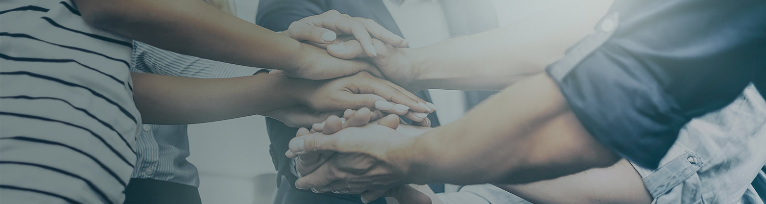 image of a people joining hands together