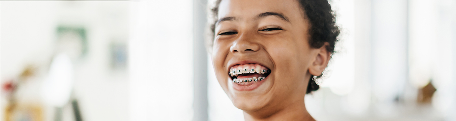 image of a girl smiling with braces