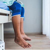 image of a patient's legs waiting to see a doctor