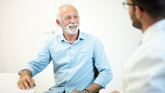 man smiling as he discusses his care options